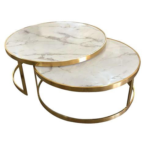 This table set features white faux marble top and a durable metal base, which combines an elegant look and industrial style. Mirabello 2 Piece Faux Marble Topped Metal Round Nesting Coffee Table Set, White / Gold