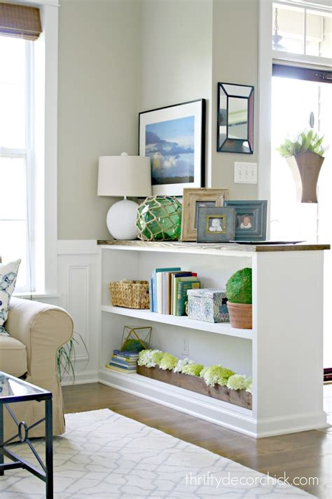 An old table was cut in half to make two stylish nightstands. Finished Half Wall Bookcase! from Thrifty Decor Chick