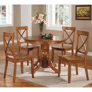 home styles 5 piece round pedestal dining set cottage oak dining table sets at hayneedle