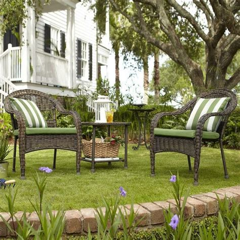 green cushions paired  striped pillows