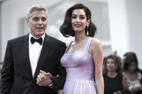 george clooney describes  twins personalities hes