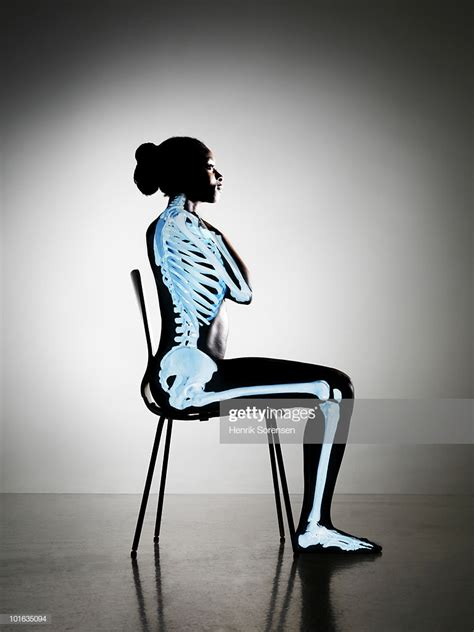 For Sitting by Up Right Sitting With Skeleton Visible Stock Photo