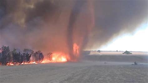 massive fire tornado sweep  outback