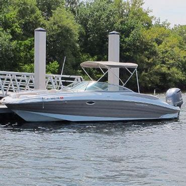 Hurricane Deck Boat On Choppy Water by Miami Boat Rentals