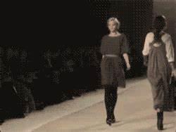 runway model trips and hits her face gif | WiffleGif