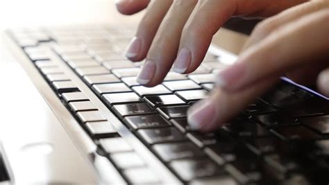 Hands Touch Typing On A Laptop Keyboard Stock Footage