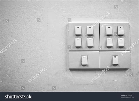 white light switch on wall stock photo 55816171