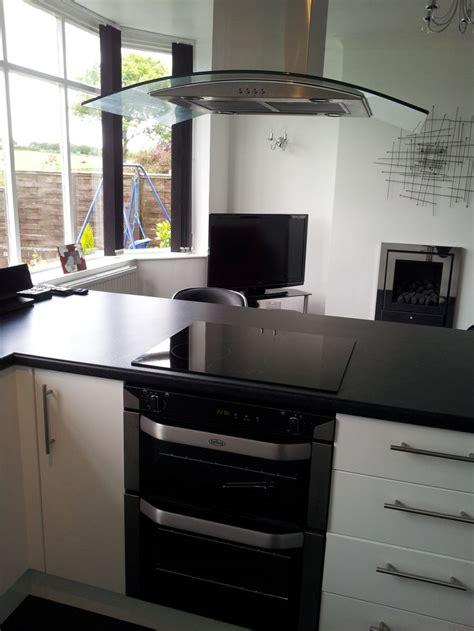sleek modern black white kitchen  breakfast bar