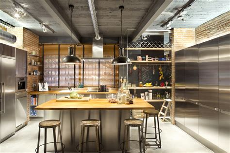 kitchen central island industrial home with interior planting and transparent walls