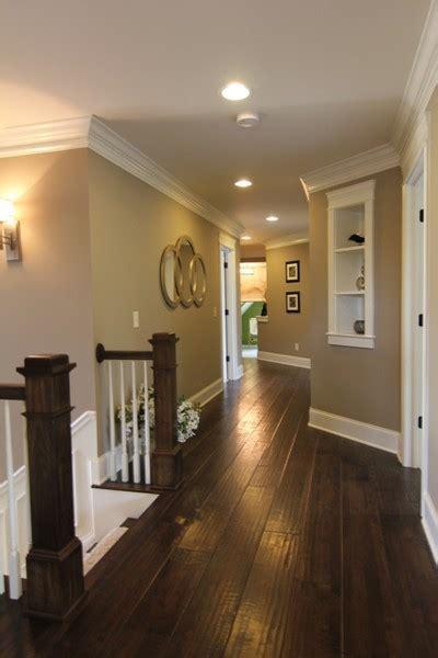 Dark floors. White trim. Warm walls.   Living room and