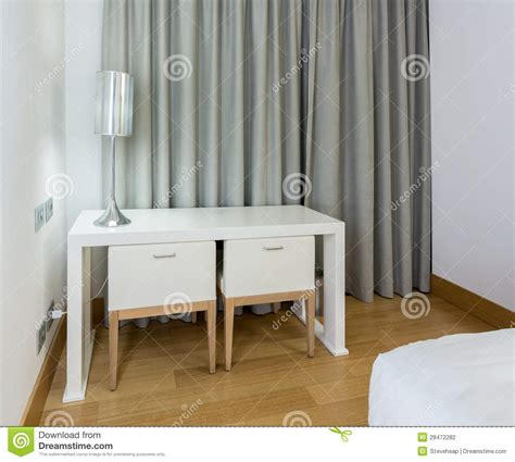 modern white table and chairs in bedroom stock photo