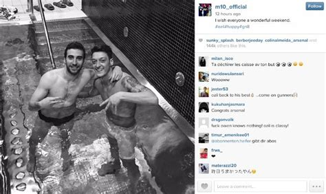 arsenal 39 s mesut ozil takes semi naked selfies as he bathes with gunners teammate after drilling