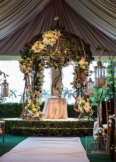 enchanted wedding altar features  chuppah overgrown