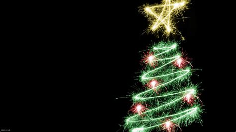 shimmering christmas tree on christmas black background