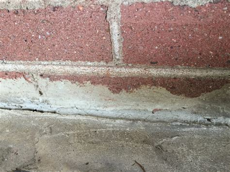 repairing a between the house and patio with mortar