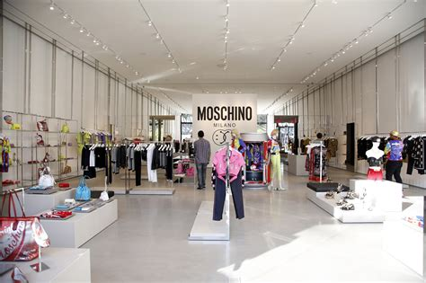 jeremy scott opens  moschino store  los angeles