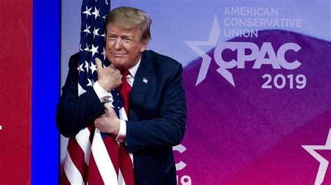 trump  american flag  hug   walks  cpac stage