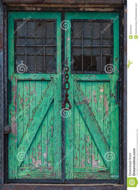 wooden warehouse door   crane hook  front stock