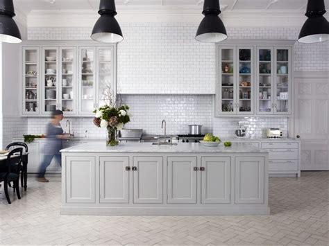 greige painted kitchen black lights white handmade tiles