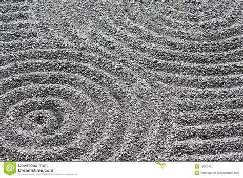 zen garden circular raked gravel pattern detail stock