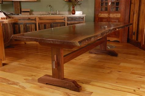 hand   edge walnut slab trestle dining table