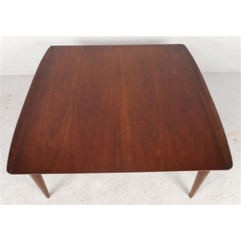 The cheapest offer starts at £15. Mid-Century Modern Square Walnut Coffee Table by Bassett | Chairish
