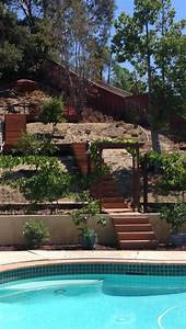 Backyard stairs and deck on hill landscaping: back