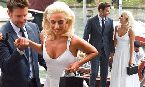Lady Gaga Holds Hands With Bradley Cooper At A Photocall