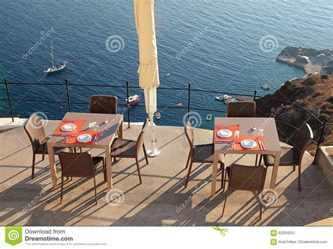 alfresco cafe on terrace sea coast santorini greece
