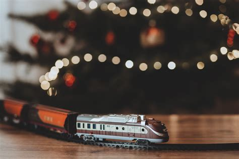 toy train going around the christmas tree freestocks org