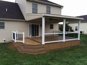 Lean-to roof over two toned Clubhouse deck - Modern - Deck