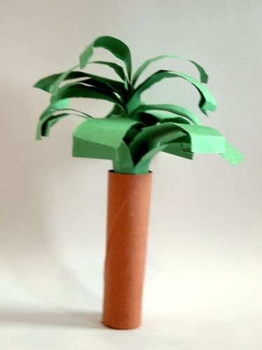 rolled paper palm trees paper palm tree roll a brown paper into a and fold green paper for leaves and stuff them