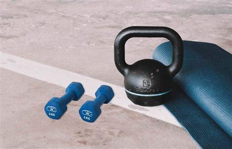 vs kettlebells dumbbells equipment feb