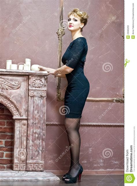 blonde   elegant black dress stock image image