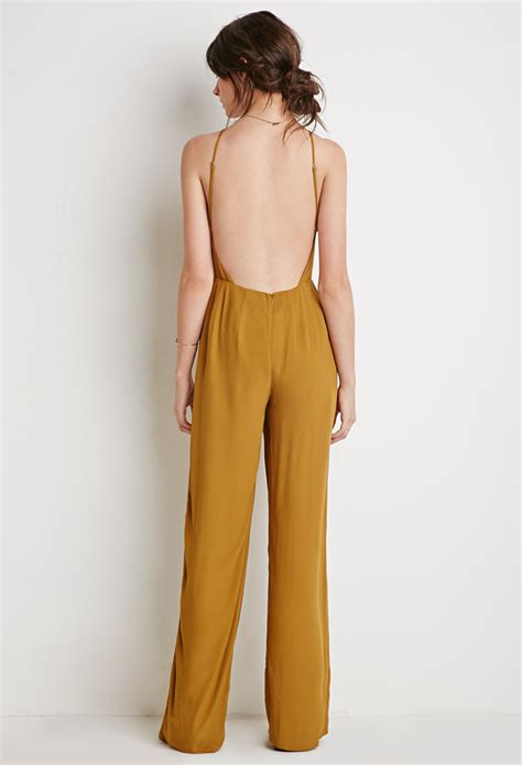 womens yellow jumpsuit forever 21 low back halter jumpsuit in yellow lyst