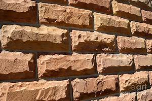 Rough Hewn Sandstone Brick Wall Of A Historic Building In