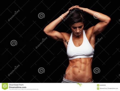 female perfect abs athlete woman muscular young posing torso sportswear against background slim preview