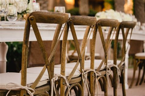 cross back wood chairs and wedding rentals for