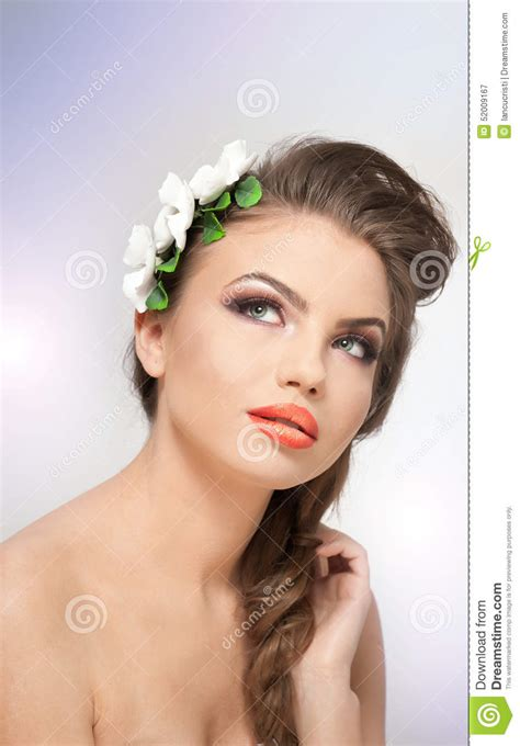 Portrait Of Beautiful Girl In Studio With White Flowers