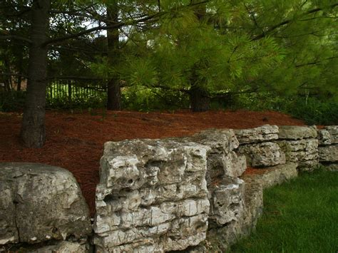 retaining wall with boulders retaining walls and outcroppings treetops landscape design inc