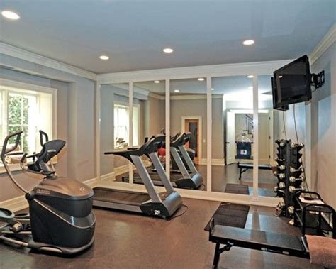 traditional home gym with mirrored wall also modern gym