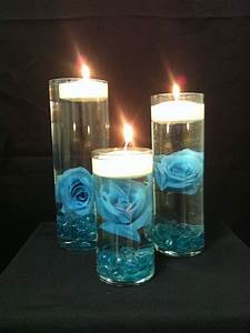Turquoise rose and floating candles centerpieces