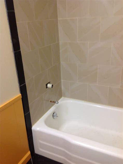 guest bathroom day  finish tub surround  trim