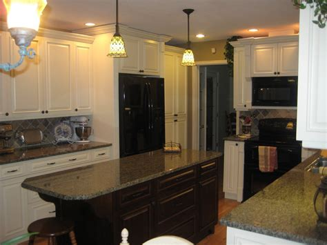 black kitchen island with granite top railing