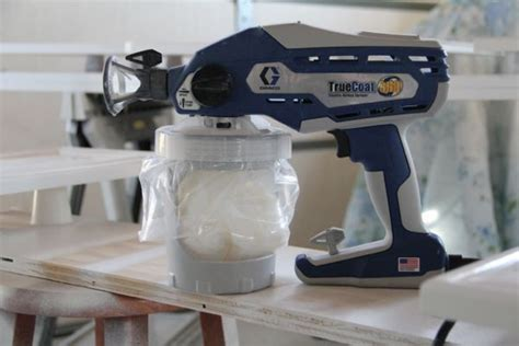 painting kitchen cabinets with sprayer how to spray paint cabinets like the pros lowes paint 7345