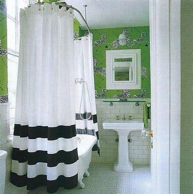 green scalamandre zebra print bathroom with white subway