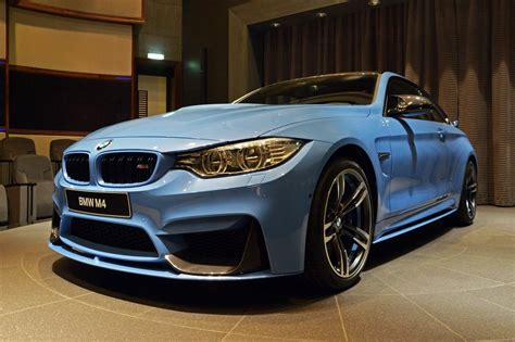 Yas Marina Blue Bmw M4 Coupe With Racing Wing