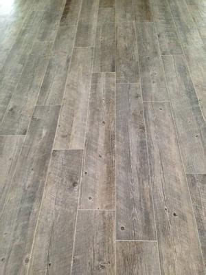 lowes flooring for basements shop style selections natural timber ash glazed porcelain indoor outdoor floor tile common 8