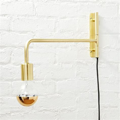 swing arm brass wall sconce cb2