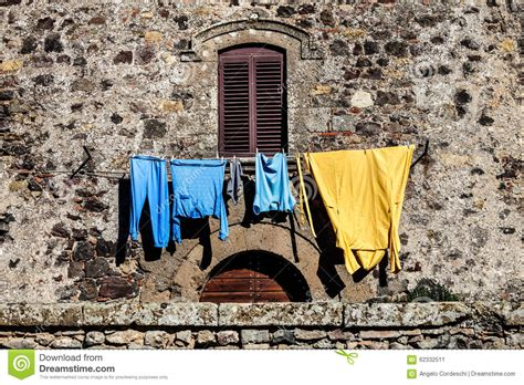 hang clothes on wall window and clothes hanging wall facade old house stock photo image 62332511